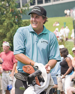 Phil Mickelson with bag of clubs - facts about phil mickelson
