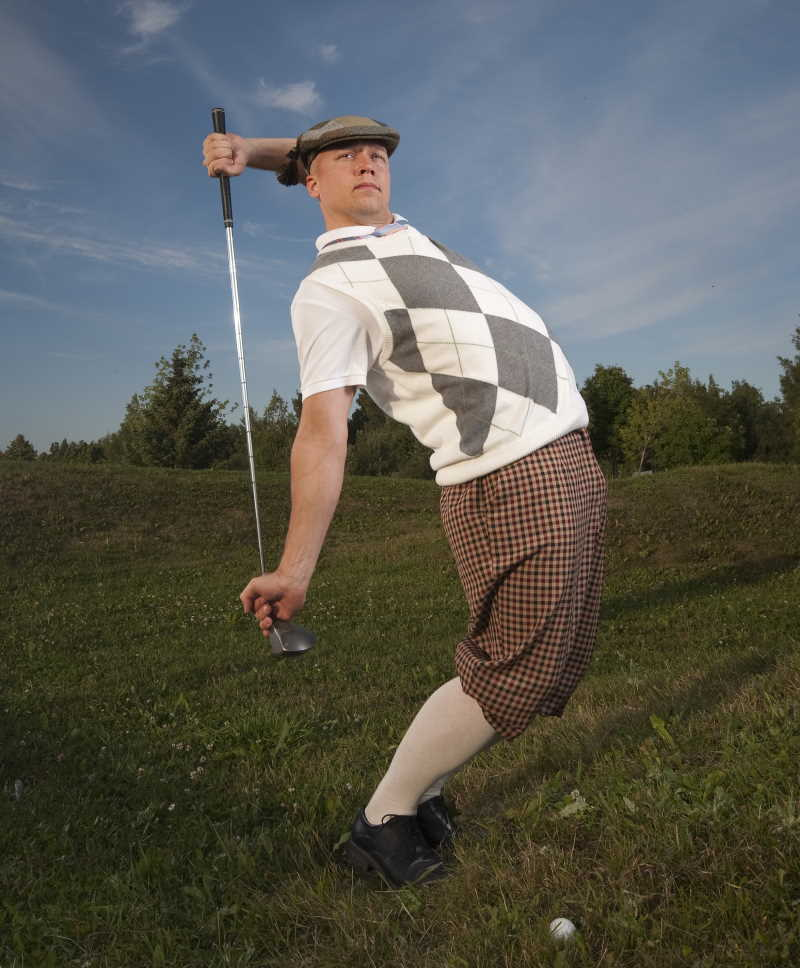 golfer with fairway wood in the ruff