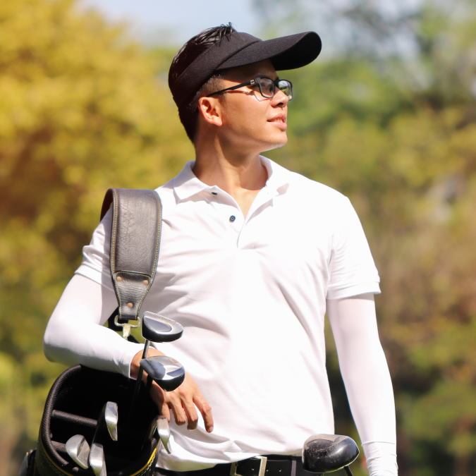 golfer on the course with bag and clubs